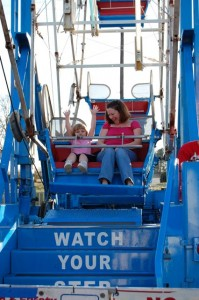 Tiller fearlessly rides the Ferris Wheel with Aunt Lisa.