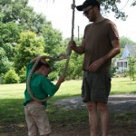 Matt helps Rollie with the rope swing.