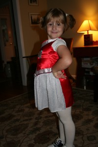 Showing off her cheerleading outfit (Bulldog colors, of course)