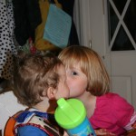Give baby positive reinforcement in form of cousin giving kisses.