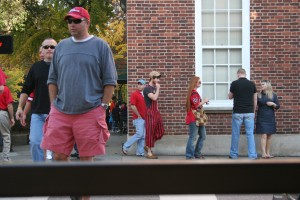 Overalls aren't just for the ladies. At least this gentleman knows that vertical stripes are slimming!