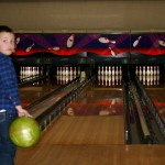Rollie was a bowling pro. He even got a strike!