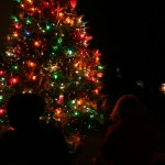 Silhouette of my kids in front of Tucker Christmas Tree.