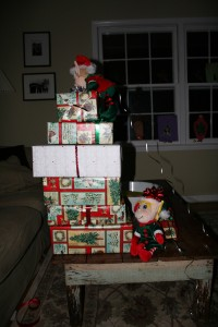The first night they were here they made a tower of presents and got into the wrapping ribbons!