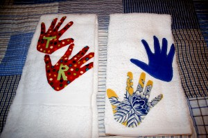 My friend Adrienne makes some beautiful handsewn gifts, and she made these for me. She traced Rollie and Tiller's handprints and put them on handtowels. I gave a set to each of the grandmothers and kept this set for myself. So sweet!