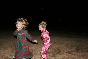 The kids ran like crazy in the front yard inbetween the big fireworks. Carlie and I cowered in fear behind some bushes.