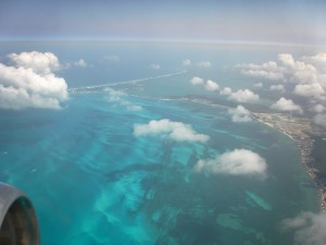 "View from the plane over Cancun. The reason i am able to take photos like this from the plane window is that i pop Xanax like candy before and during the flight so as not to give in to my fear and run up and down the aisles screaming, ""We're going down! We're all gonna die!"""