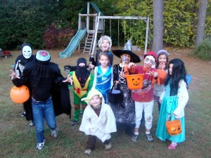 We met at a neighbor's house before going out for trick or treating. Here's the whole pack of them. Damn cute. One of these kids even went trick or treating by himself with the big kids, and I can't be friends with his mother anymore, because that is unacceptable. I am the mother of young children, not old children who trick or treat on their own.