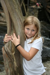 And here she is today. Brownie bridging ceremony at Stone Mountain Park Grist Mill. Almost 8 years old, 2nd grade, October 2013.