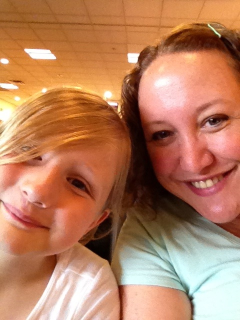 Waiting at the ATL airport. Her first ever plane ride. See that smile on MY face? Xanax.
