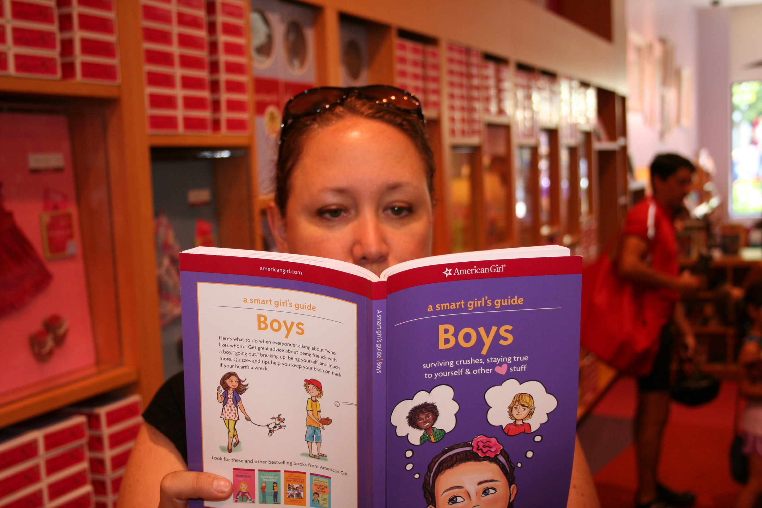 Caught reading at the American Girl store.