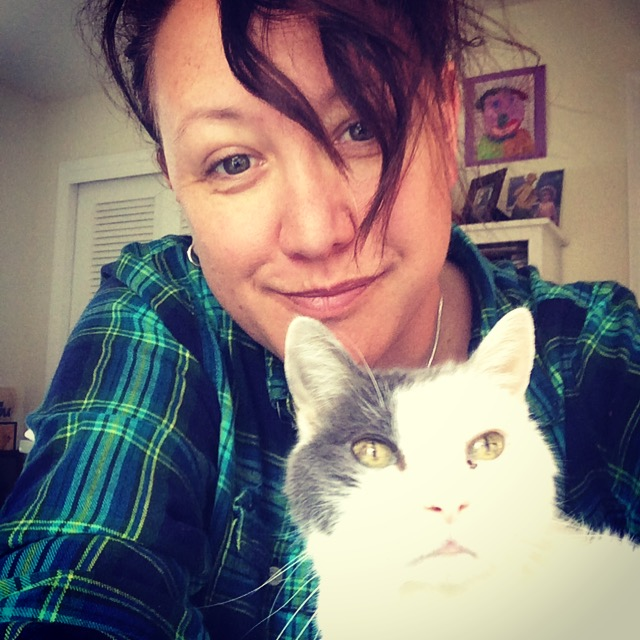 Last photo of me and my girl. I'm going to miss her climbing up in my lap while I work, and sneezing on my keyboard.